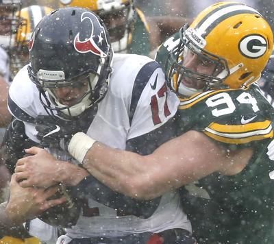 Dean Lowry sacks Brock Osweiler, AP photo