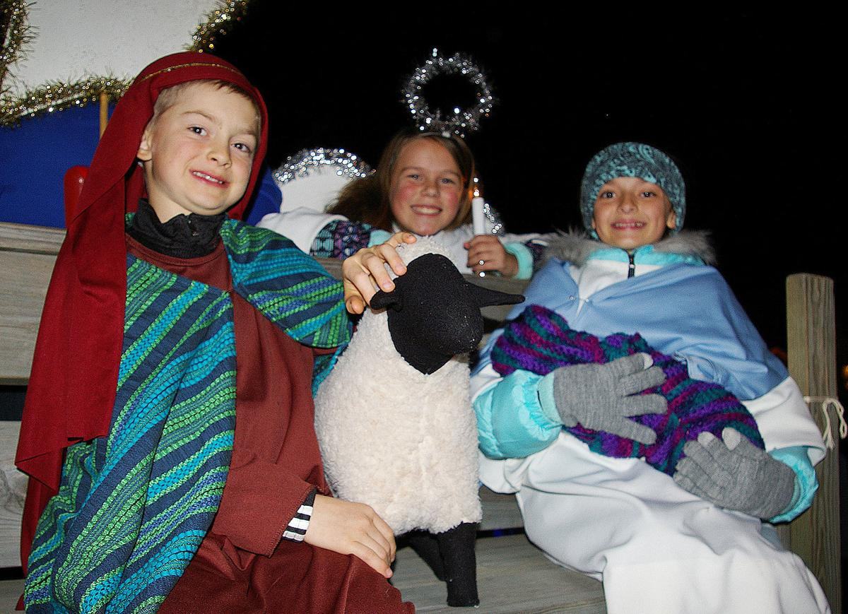 Holy Family rides on Waupun holiday float