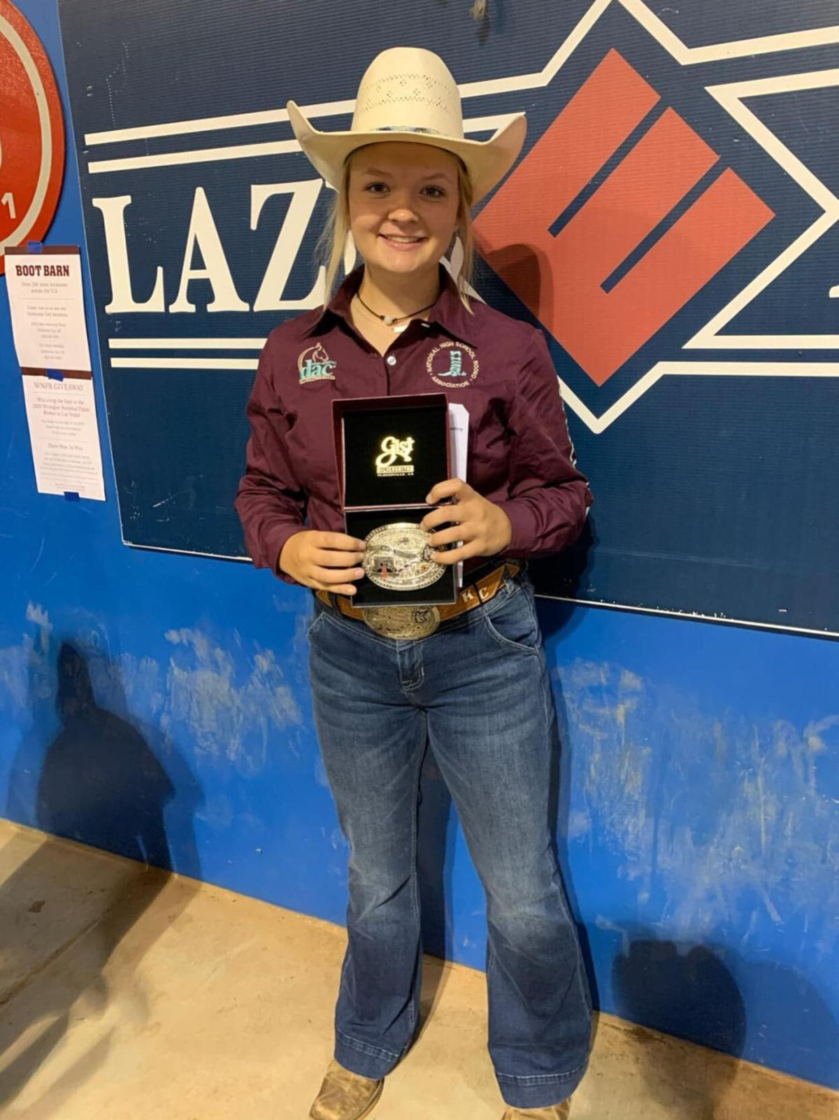 Krista Cook holds buckle