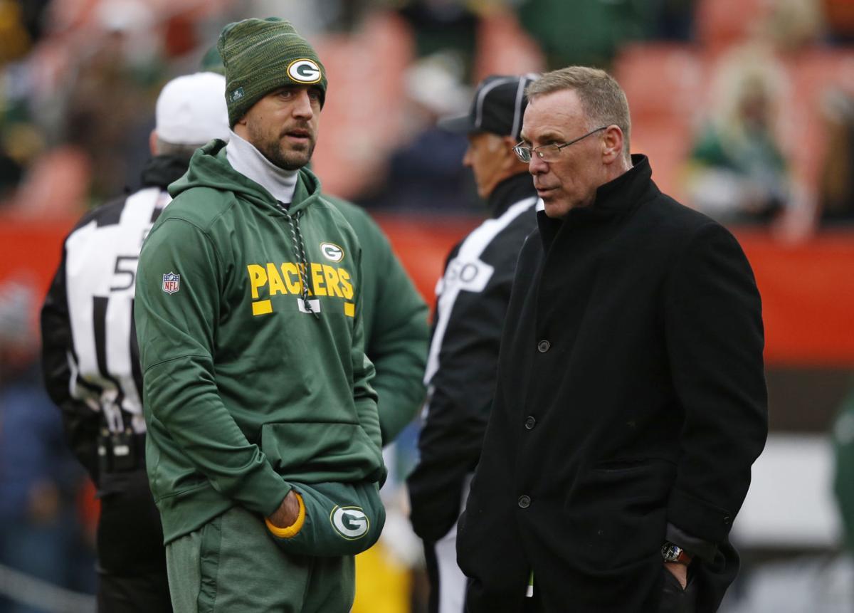 Aaron Rodgers, John Dorsey, AP photo