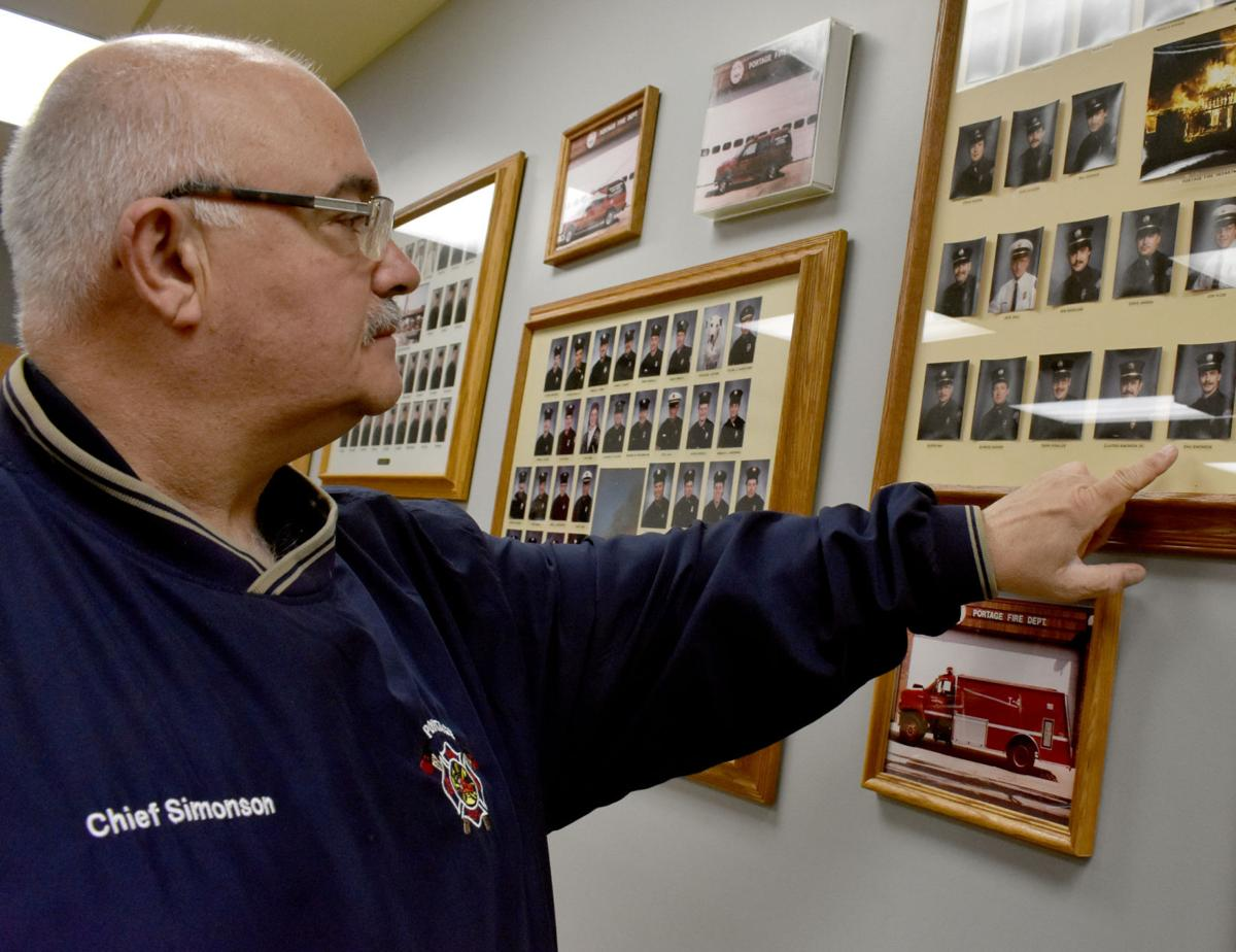 Chief Simonson shows off memorial wall