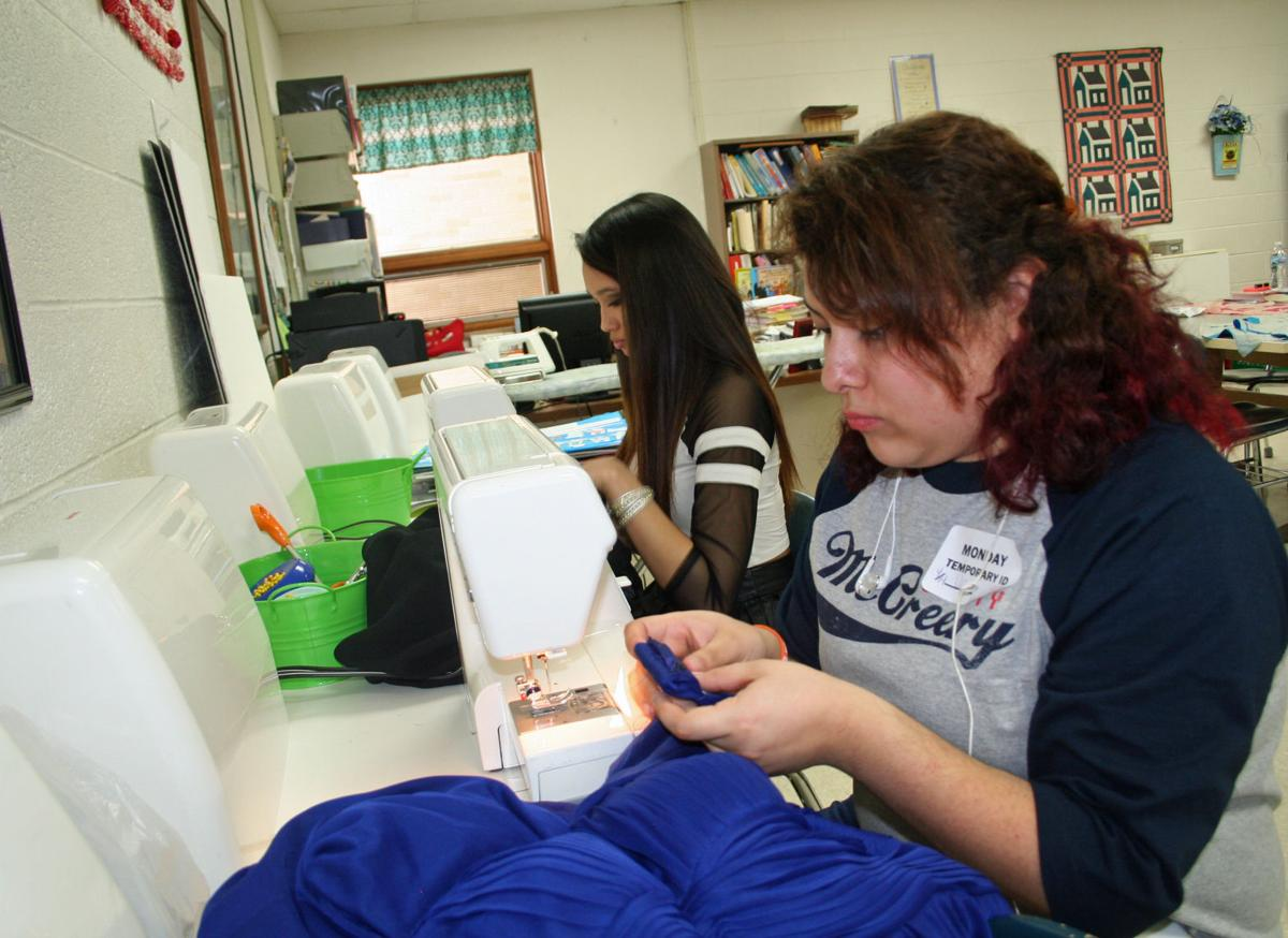 Students make alterations to dresses