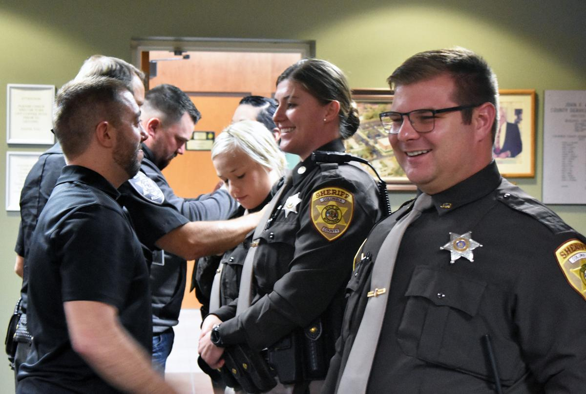 Deputies react after badges pinned on