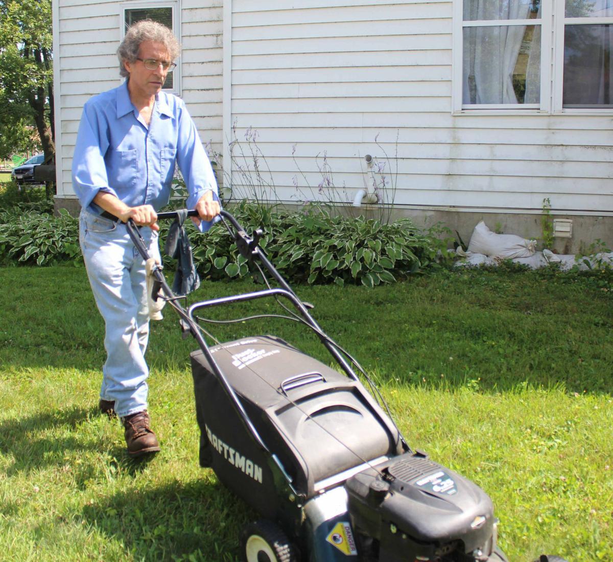 Dave mows lawn