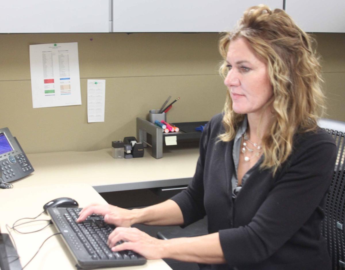 Nicole sits at desk 3