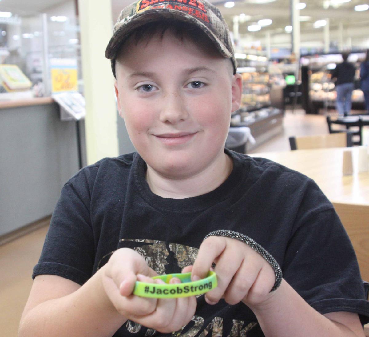 Jacob shows bracelet