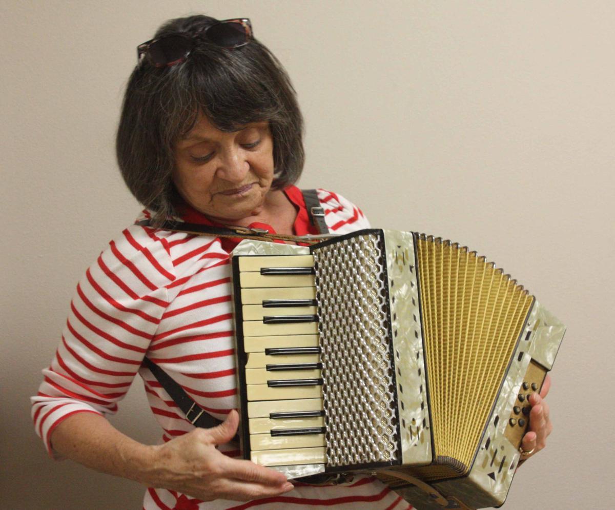 Barb plays accordion