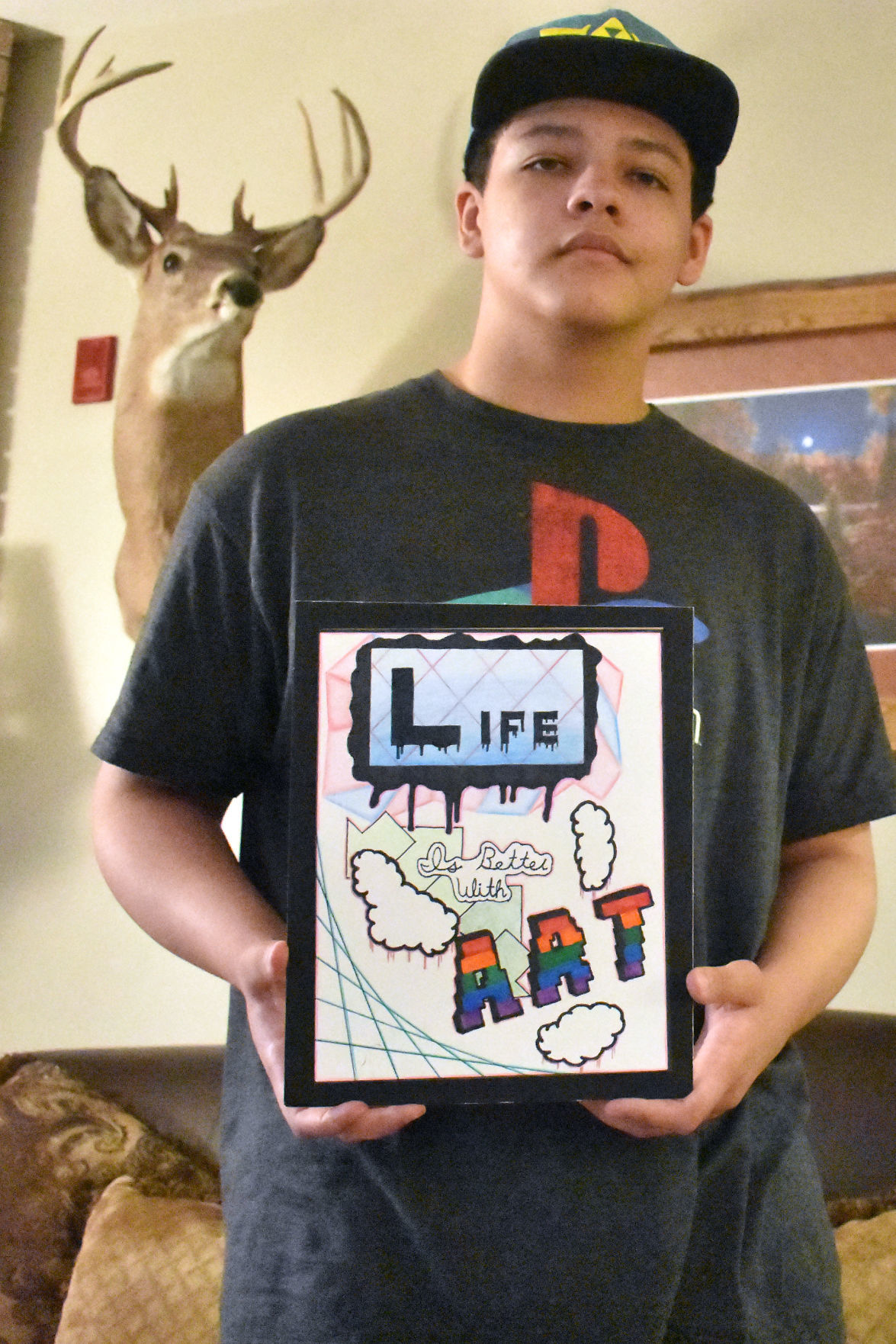 Marcus Howell holds artwork he drew