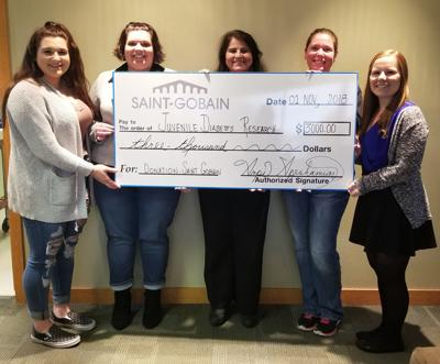 St. Gobain donates to JDRF team