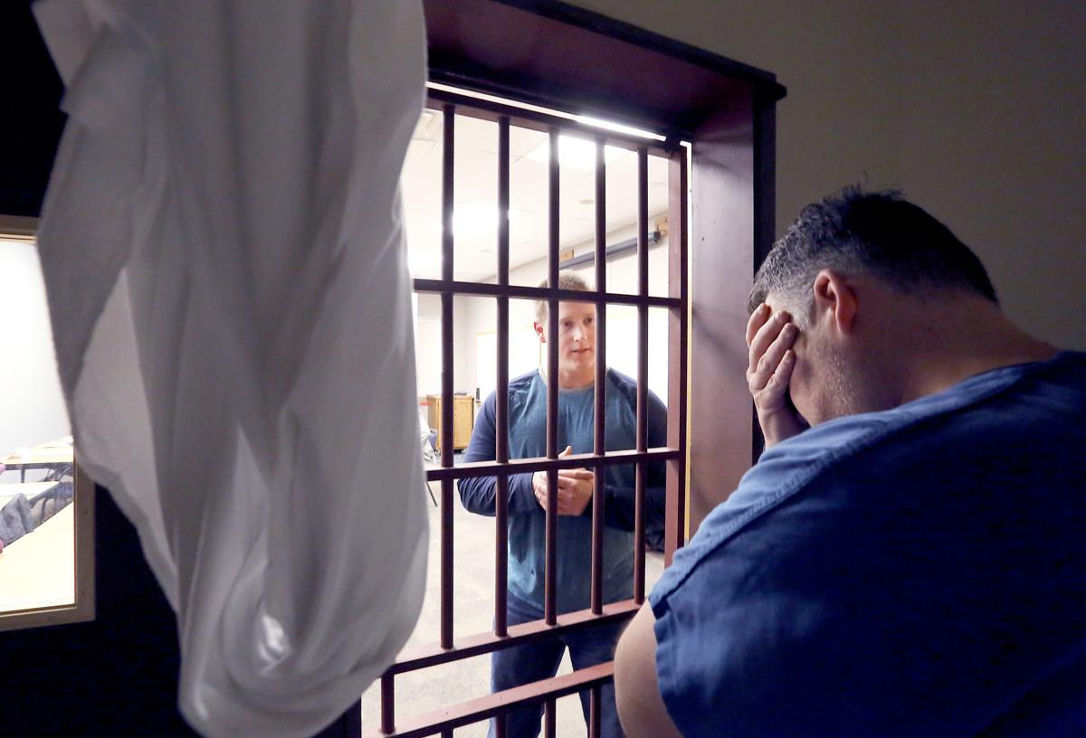 Deputy and actor in mock jail cell at training