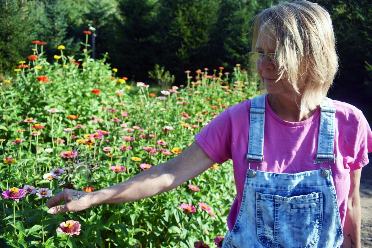 Joanne Alt stands in the garden