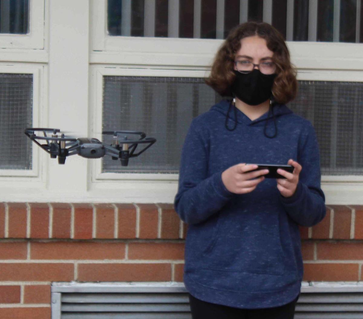 Olivia watches drone