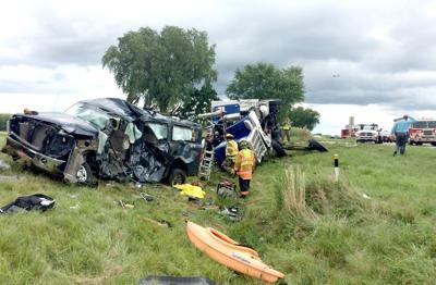 Woman's name released in fatal van-semi crash near Randolph