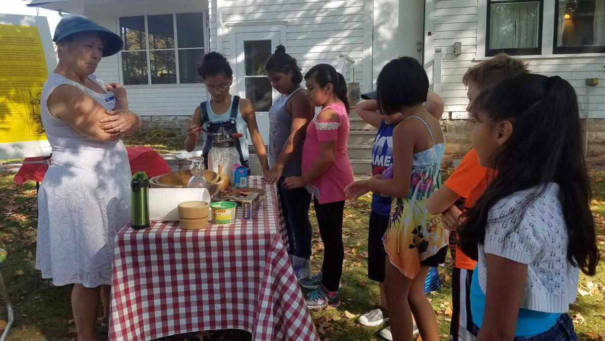 Fourth-graders look into the past during Bowman House visit