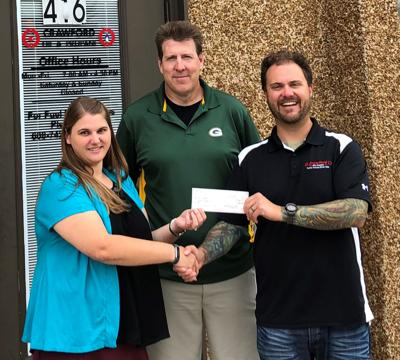 Crawford Oil gives $600 to homeless shelter