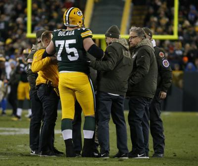 Bryan Bulaga knee injury, AP photo