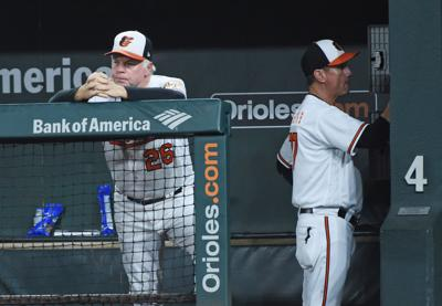 Baltimore Orioles manager Buck Showalter, left, shows his frustration in the dugout after losing to the Toronto Blue Jays on September 18, 2018, at Oriole Park at Camden Yards in Baltimore, Md. On right is bench coach John Russell. The loss was the 108th of the season for the Orioles, breaking the team's previous single-season loss record set in 1988.