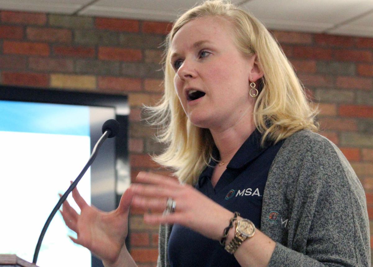 Raine speaks at meeting