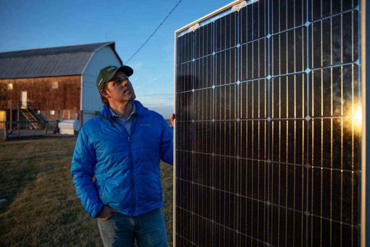 Dan Litchfield by solar panels