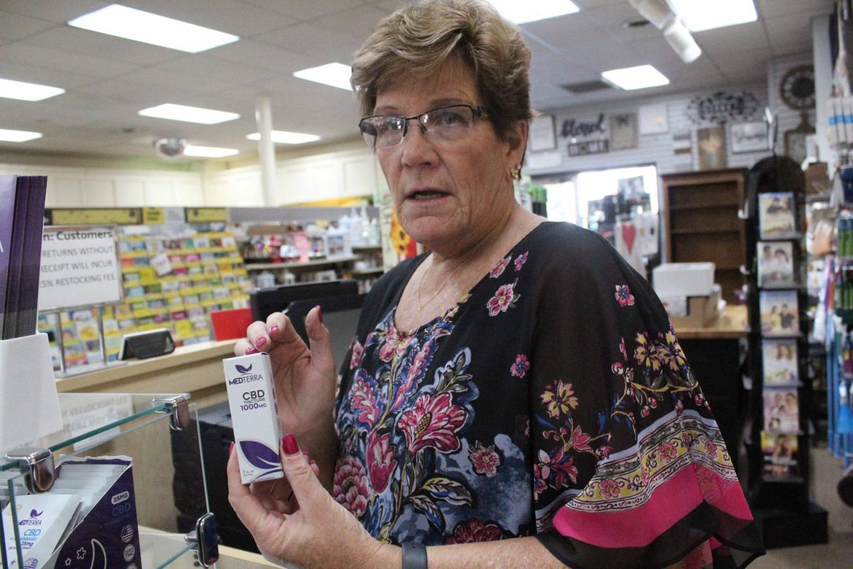 Peggy shows CBD oil 2 (Reedsburg)
