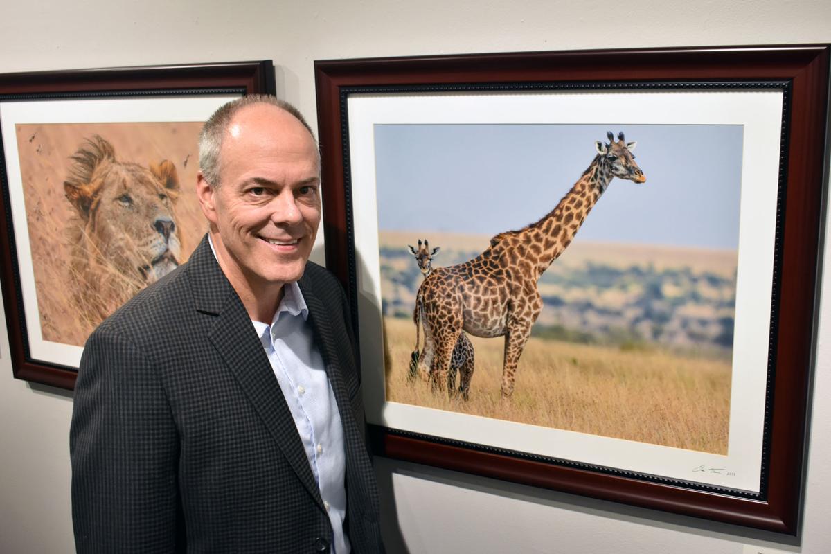 Dennis Trecek with giraffe photo