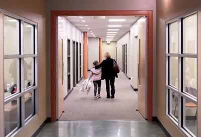Donna and Natalie walking down hallway