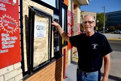 Mitchel Craig shows broken window