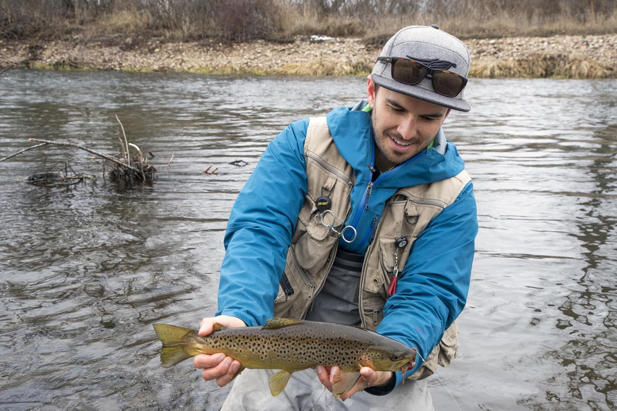 Steve Veals holds 14-inch brown trout he hooked along the Boise River with an articulated streamer pattern on February 24, 2019. Veals said he needed a distraction from a series of personal losses in his family. So he turned to fishing — every day for a year.
