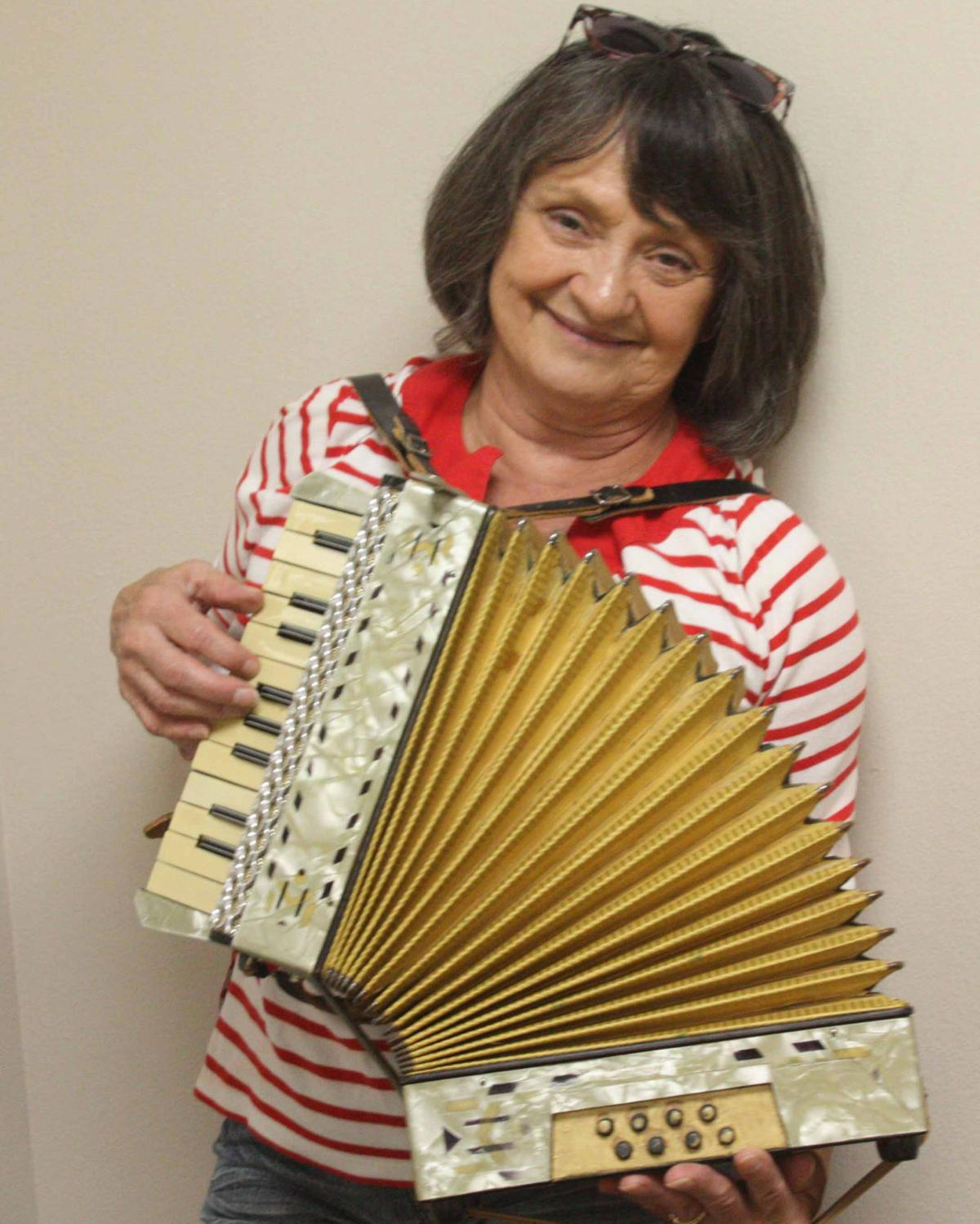 Barb poses with accordion