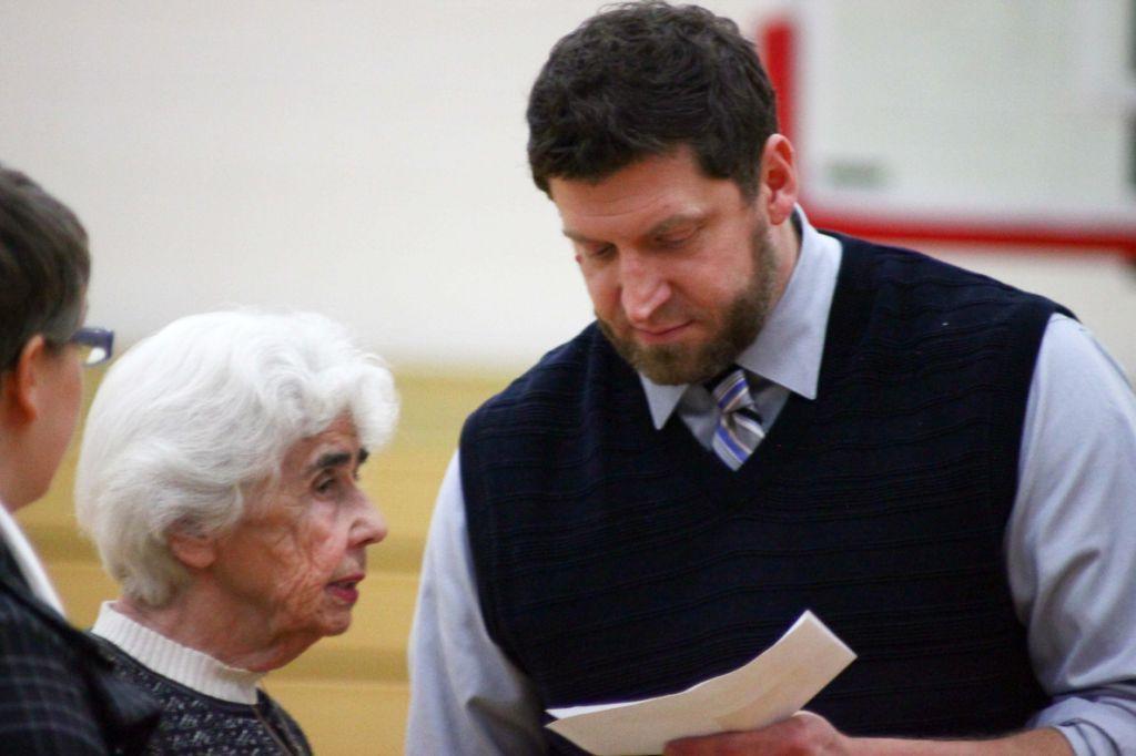 Renata Laxova speaks with Necedah High School Principal Mark Becker