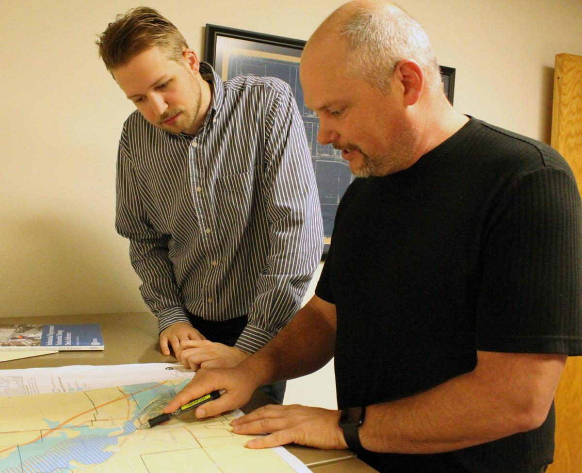 Zach and Randy look at flood map