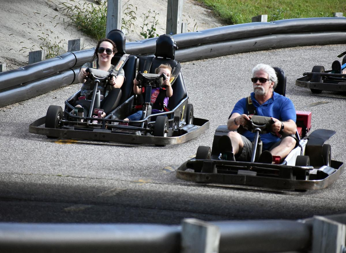 People racing go karts in the Dells