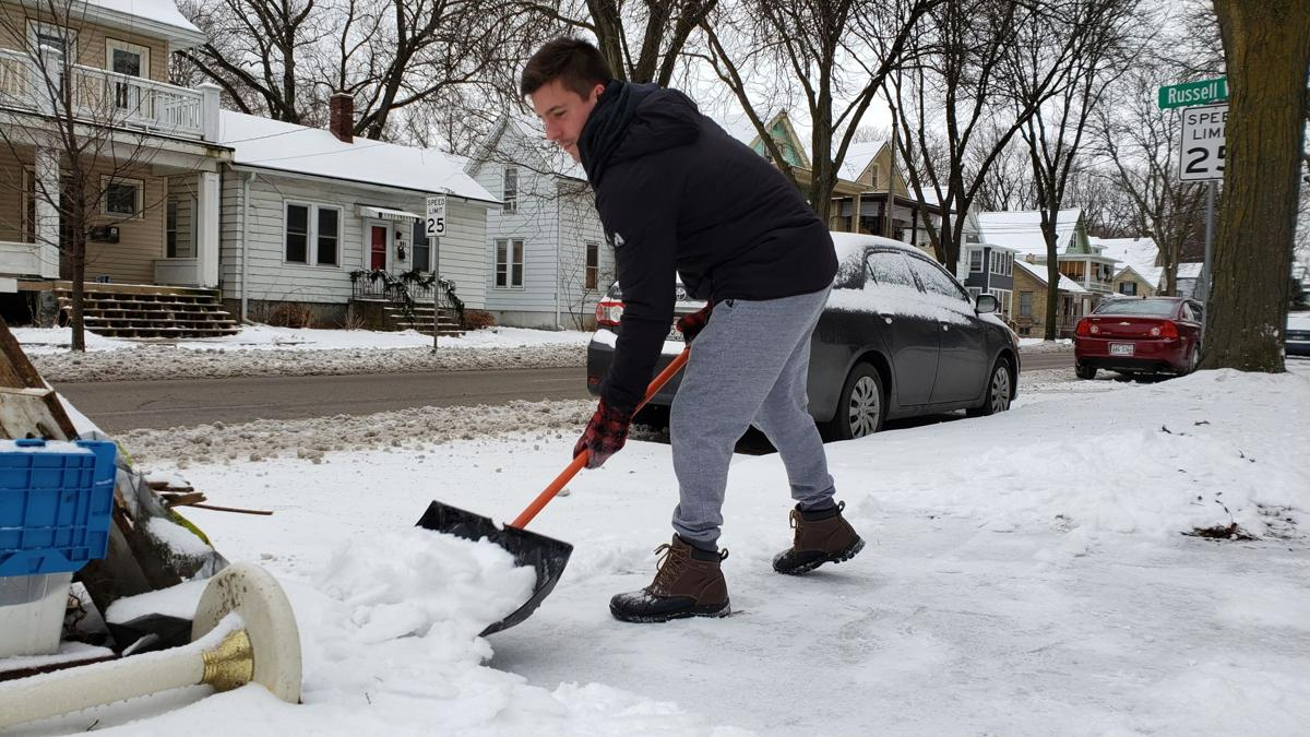 Man shoveling snow in Madison 1-11-20