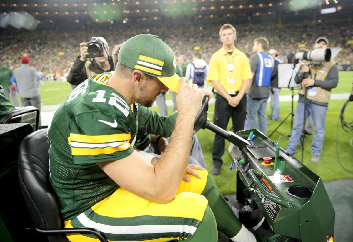 Aaron Rodgers carted off field, State Journal photo