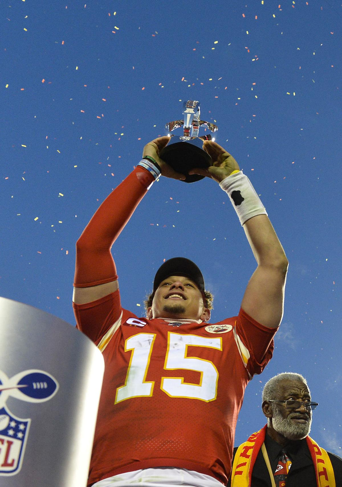 Kansas City Chiefs quarterback Patrick Mahomes hoists the Lamar Hunt AFC Championship trophy over his head after a 35-24 win against the Tennessee Titans in the conference championship game on January 19, 2020, at Arrowhead Stadium in Kansas City, Mo.
