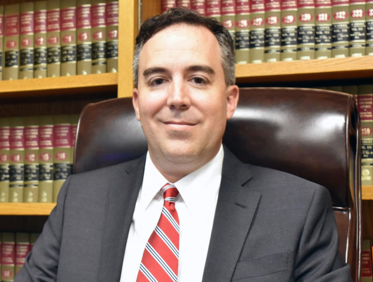 Judge Chad Hendee seated in Marquette County