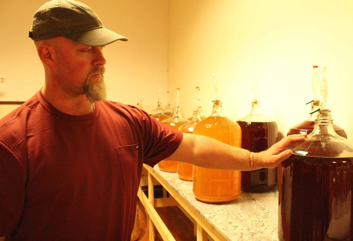 Brad Allen shows fermenting process