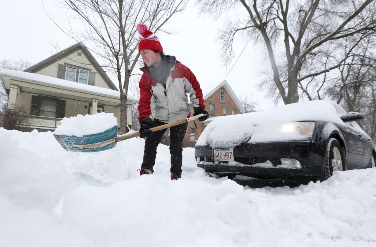 Photos: Winter storm closes schools and creates treacherous roads