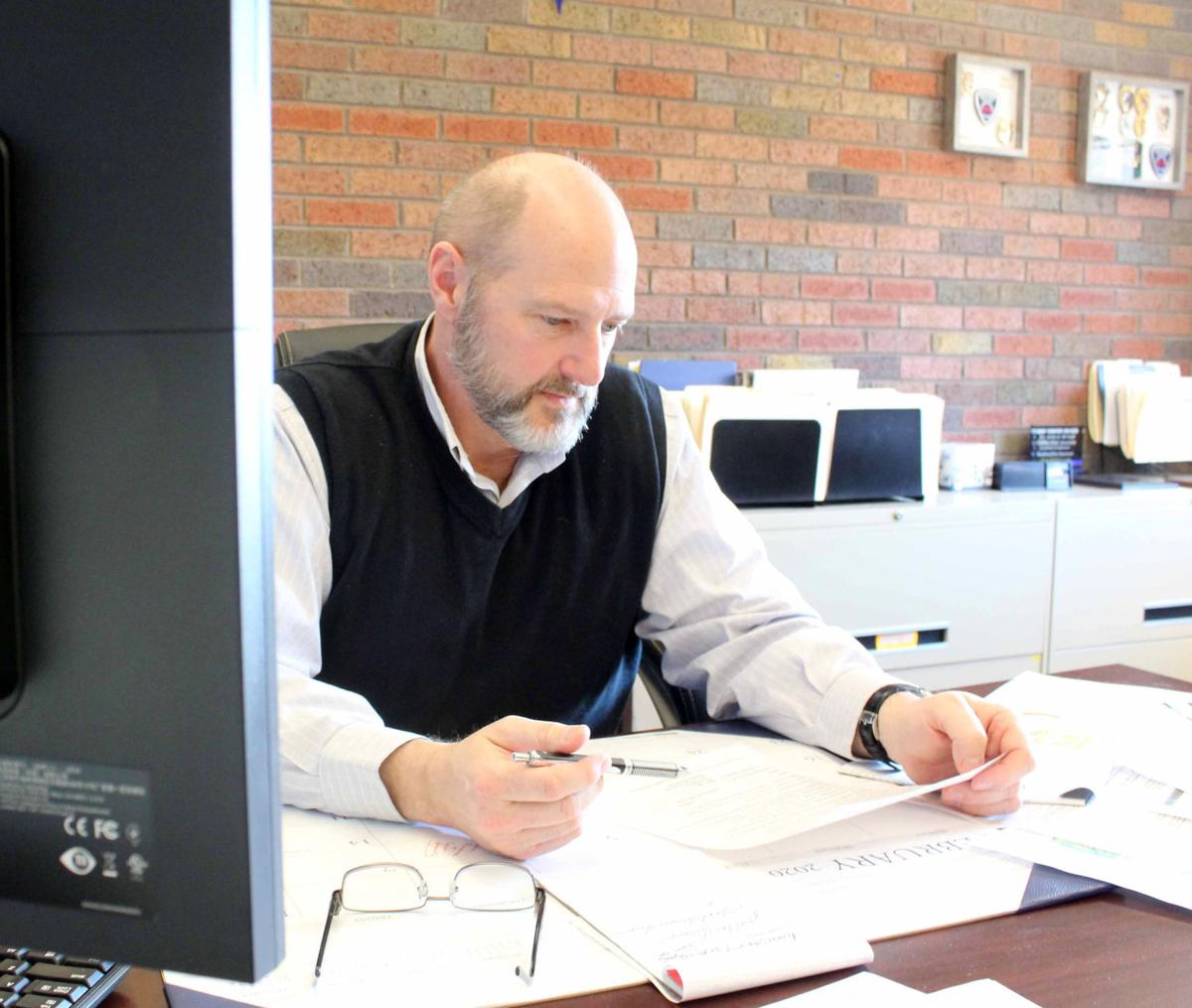 Tim glances at list of committess and commissions