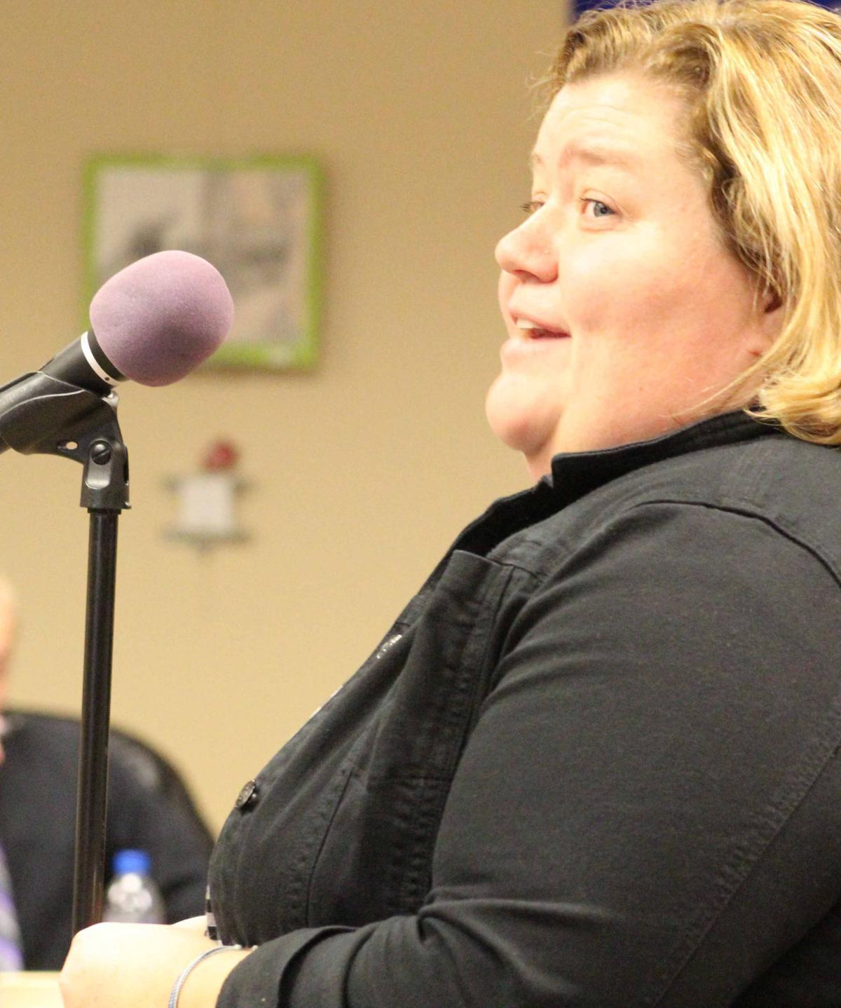 Jenny speaks at board meeting
