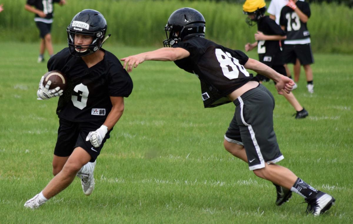 Prep football photo: Portage's Austen Stensrud eludes a tackle