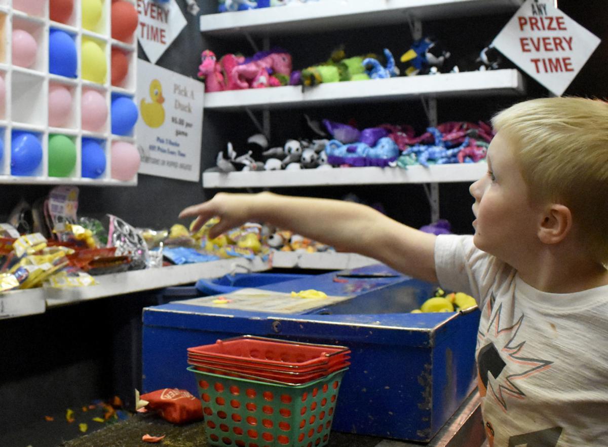 Camden, 6, pops balloons at fair (copy)