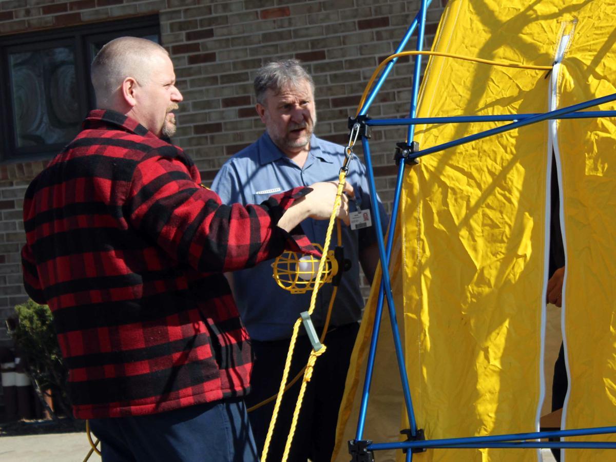 Kevin and Larry set up tent RAMC coronavirus