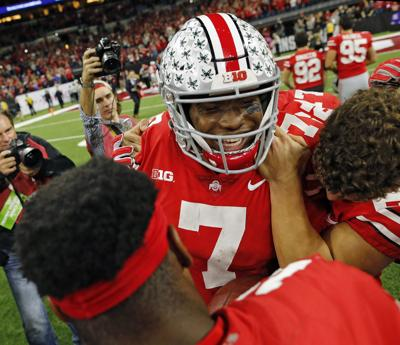 Ohio State Buckeyes quarterback Dwayne Haskins Jr. (7) celebrates with teammates after beating the Northwestern Wildcats 45-24 in the Big Ten Championship game on Saturday, Dec. 1, 2018 at Lucas Oil Stadium in Indianapolis, Ind.