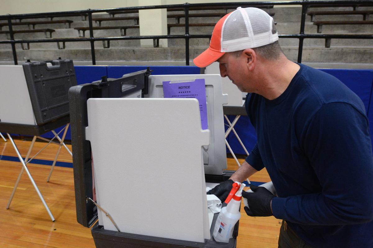 Sanitizing voting booth