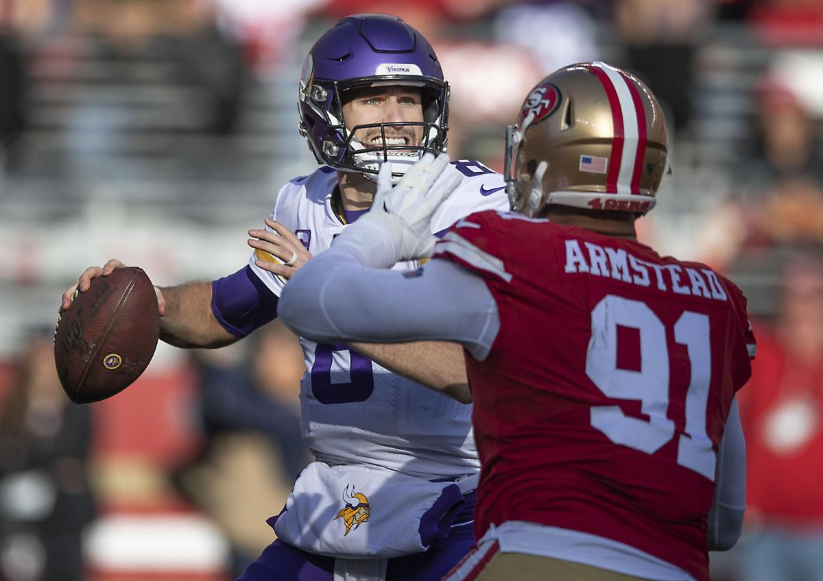 Minnesota Vikings quarterback Kirk Cousins is pressured in the pocket by San Francisco 49ers defensive end Arik Armstead (91), leading to a second-quarter sack during the NFC Divisional Round Playoffs at Levi's Stadium in Santa Clara, Calif., on Saturday, Jan. 11, 2020. The 49ers advanced, 27-10.
