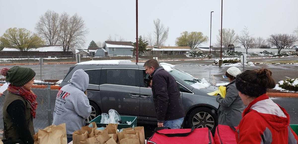 Schools continue meal programs - Whipple Elem distribution
