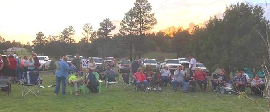 People on the lawn at dusk