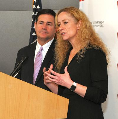 Gov. Doug Ducey and State Health Director Cara Christ