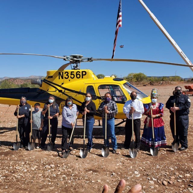 Ground breaking pic in front of helicopter